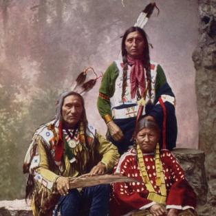 Chief Little Wound, son and wife in elk tooth dress